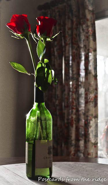 bottiglia con rosa centrotavola